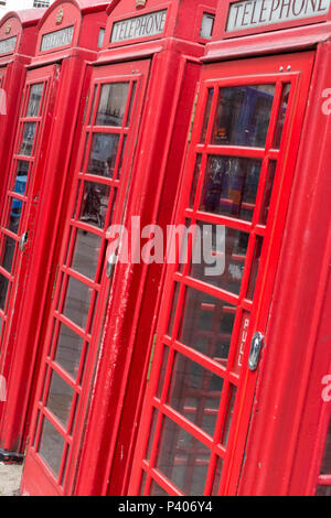 a row of traditional red gpo telephone boxes or callboxed in central london, uk. - Stock Photo