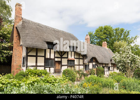 Shottery, Warwickshire, UK - June 18th 2018: Anne Hathaway's half-timbered Cottage viewed from the garden. - Stock Photo