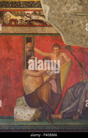 Dionysian Mysteries (Bacchian Mysteries) depicted in the Roman fresco in the triclinium (Roman dining room) in the Villa of the Mysteries (Villa dei Misteri) in the archaeological site of Pompeii (Pompei) near Naples, Campania, Italy. Initiation rite from the mysterious cult of Dionysus (Bacchus) is probably depicted in the murals. This fresco shows a young satyr being offered a bowl of wine by Silenus while behind him, another satyr holds up a frightening mask which the drinking satyr sees reflected in the bowl. - Stock Photo