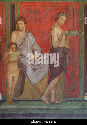 Dionysian Mysteries (Bacchian Mysteries) depicted in the Roman fresco in the triclinium (Roman dining room) in the Villa of the Mysteries (Villa dei Misteri) in the archaeological site of Pompeii (Pompei) near Naples, Campania, Italy. Initiation rite from the mysterious cult of Dionysus (Bacchus) is probably depicted in the murals. This fresco shows a priestess or matron seated on a throne, by which stands a small boy reading a scroll - presumably the declaration of the initiation. On the other side of the throne the young initiate is shown in a purple robe and myrtle crown, holding a sprig of - Stock Photo