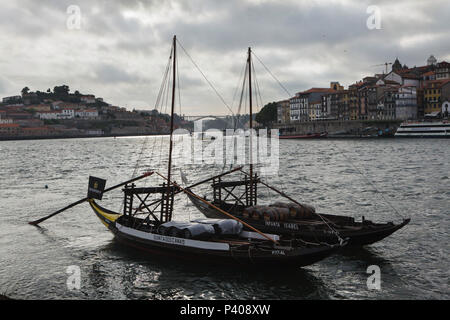 Typical rabelo boats used to transport port wine on the River Douro in Porto, Portugal. - Stock Photo