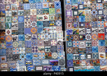 Souvenir refrigerator magnets decorated as traditional Portuguese azulejo tiles on sale in Porto, Portugal. - Stock Photo
