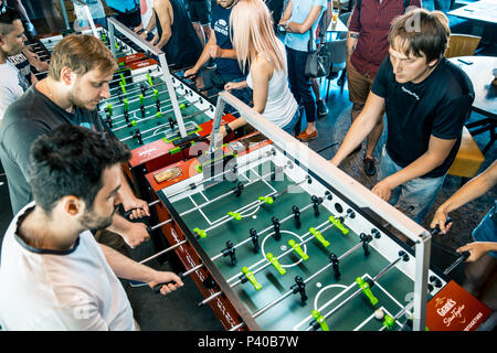 Photo KYIV, UKRAINE, bar league of Grants KickerKicker 10 June 2018. Active men and women have fun during table soccer game. Competitions and qualifyi - Stock Photo