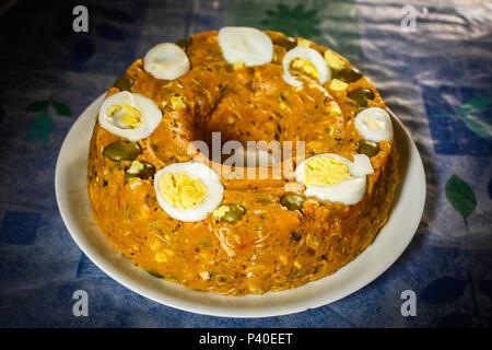 Na foto o cuscuz paulista, preparado a base de farinha de milho, decorado com ovos. - Stock Photo