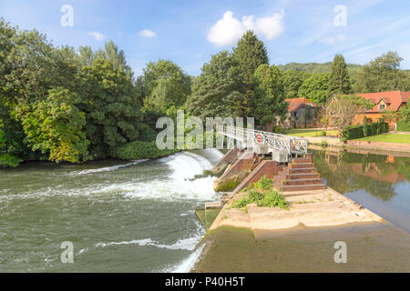 Flood waters passing through a weir on the River Thames at Streatley, Berkshire, England, United Kingdom. - Stock Photo