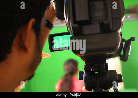 Camera at media conference in green screen, Behind the scene. Actor in front of the camera on the film set in film studio. - Stock Photo