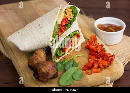 vegetarian bhaji and roasted red pepper wrap with mango chutney and spinach - Stock Photo