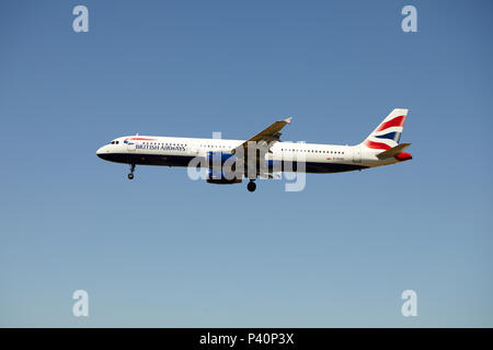 A British Airways Airbus A321-231, registration G-EUXD, approaching a landing. - Stock Photo