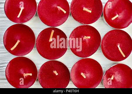 Red tea light candles background. Close up collection of red candles in metal base. Paraffin unscented candles. - Stock Photo