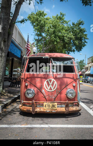 old rusty VW van parked in the street in Tarpon Springs USA. - Stock Photo