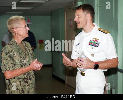 Photograph of Logistics Group Western Pacific commander Donald Gabrielson speaking with Captain Jeana Kanne onboard the naval hospital ship USNS Mercy, May 23, 2018. () - Stock Photo