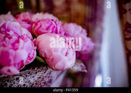 Elegant bouquet of a lot of peonies of pink color close up. Beautiful flower for any holiday. Lots of pretty and romantic flowers in floral shop. Copy space - Stock Photo