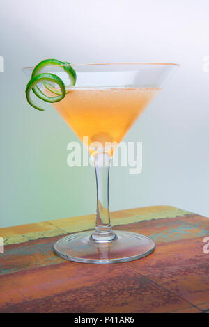 Golden Gimlet in martini glass - Stock Photo