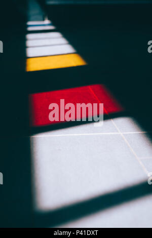 Colored windows light on the ground of an subway - Stock Photo
