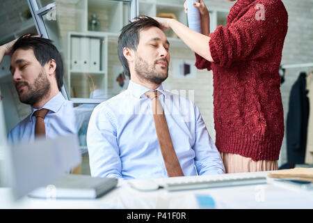 Man having visit to hairstylist - Stock Photo