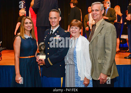 Chief Warrant Officer 2 Ryan Anderson of the California National Guard displays the MacArthur Leadership Award on June 1 at the Pentagon, moments after receiving the prestigious honor from Chief of Staff of the Army Gen. Mark A. Milley. Anderson is joined by his wife, Angela, father, Robert, and Susan Anderson. The award is presented annually to one National Guard warrant officer and 28 Army officers overall nationwide who exemplify the ideals for which Gen. Douglas MacArthur stood: duty, honor, country. - Stock Photo