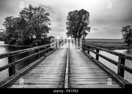 Old wooden bridge over the river Bosut near Vinkovci, Croatia. - Stock Photo