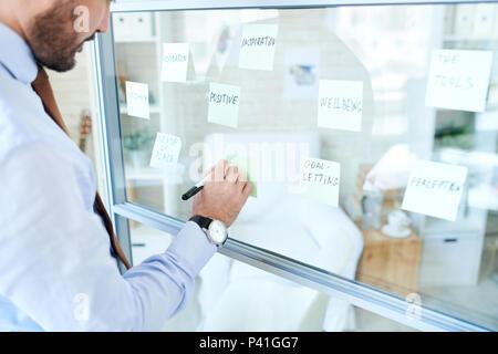 Man arranging stickers and making plan
