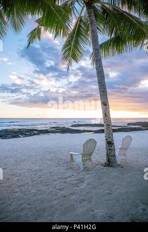 Two deck chairs under palm tree on an empty beach at Lefaga, Matautu, Upolu Island, Western Samoa, South Pacific - portrait orientation - Stock Photo