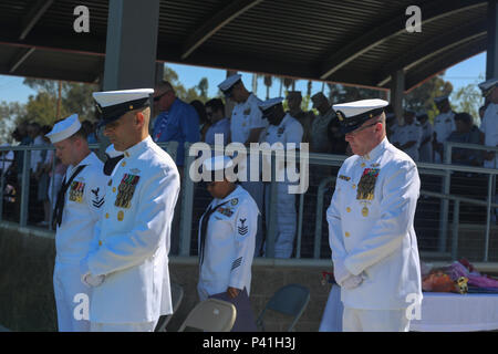 MARINE CORPS BASE CAMP PENDLETON, Calif. - Master Chief Petty Officer Frank Dominguez, left, and Master Chief Petty Officer Michael Smith, bow their head for the invocation during the change of charge and retirement ceremony for Smith on Camp Pendleton June 3, 2016. Smith is retiring after 30 years of honorable service in the United States Navy. Dominguez, a Superior, Arizona native, is replacing Smith, a Ridgecrest native, as the command master chief of I Marine Expeditionary Force. (U.S. Marine Corps Photo By Cpl. Garrett White/Released) - Stock Photo