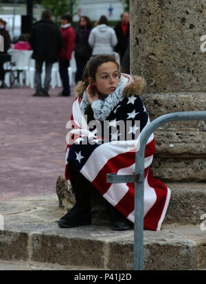 Marie Dulas, a 13-year-old French girl, watches the 82nd Airborne Division Band perform a free concert in Sainte-Mere-Eglise, France on June 3, 2016, in honor of the 72nd Anniversary of D-Day.  More than 380 service members from Europe and affiliated D-Day historical units are participating in the 72nd Anniversary as part of Joint Task Force D-Day 72. The Task Force, based in Saint Mere Eglise, France, is supporting local events across Normandy, From May 30 – 6 June, 2016 to commemorate the selfless actions by the allies on D-Day that continue to resonate 72 years later. - Stock Photo