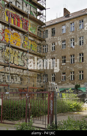 Berlin, Germany, Baugeruest and backyard in an unsanierten old building in the Petersburger Strasse in Berlin-Friedrichshain - Stock Photo