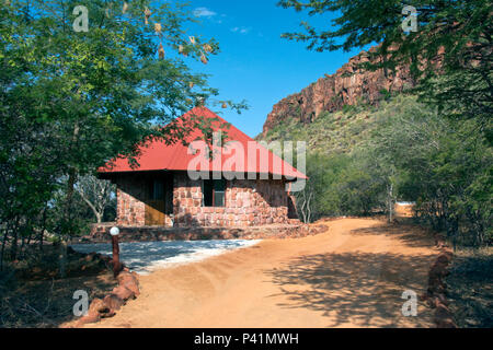 Chalets at the Waterberg Plateau Lodge, situated below the Waterberg (Afrikaans: Water Mountain) Plateau with a view of the plains of the Kalahari. - Stock Photo