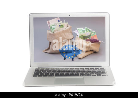 Laptop with Two money bag with euro and glass piggy bank with Flag of European Union on screen Isolated on white background - Stock Photo