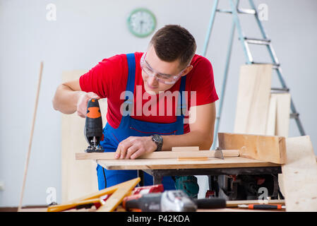 Contractor working in the workshop - Stock Photo