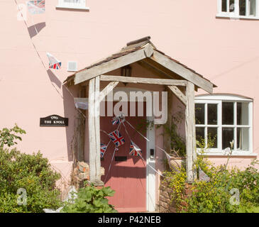Bunting flags on house celebrating royal wedding of Prince harry and Meghan Markle, Suffolk, England, UK May 19, 2018  Duke and Duchess of Sussex - Stock Photo