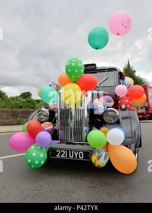Glasgow, Scotland, UK. 20th, June, 2018. Taxi drivers today decorated their cabs for the annual Taxi run taking disabled children on a day trip to Troon in Ayrshire. - Stock Photo