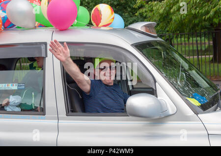 Glasgow, Scotland, UK. 20th June, 2018. The 73rd Glasgow Taxi outing is an annual event where over 100 taxi drivers of the city dress up in fancy costumes, decorate their taxis and take more than 300 children with special needs on a day trip to the seaside town of Troon. Pictured male taxi driver at the wheel of his cab giving a wave out of the window. Credit: Skully/Alamy Live News - Stock Photo