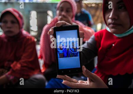 June 21, 2018 - Simalungun, North Sumatra, Indonesia - Relatives of