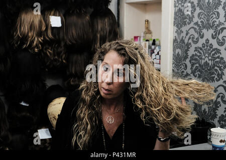 Bnei Brak, Israel. 20th June, 2018. BRACHA KEYNAN, haredi wig manufacturer and stylist for over 30 years, manages her shop in Bnei Brak. A powerful wave is sweeping the female haredi ultra-Orthodox sector towards modern fashion and design. With an increase in haredi women employment (73% between the ages of 25-64), most now working outside of the haredi society and an increase in the use of Internet (47% of the haredi society as of 2016), the influence of the general secular society in Israel and that of the international community is on the rise and fuels new powerful haredi fashion trends. C - Stock Photo