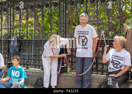 Westminster, London, UK; 20th June 2018; Protesters Chain Themselves to railings Outside Parliament To Urge That Britain Signs the UN Global Ban on Nuclear Weapons Credit: Ian Stewart/Alamy Live News - Stock Photo