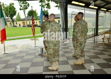 U.S. Army Lt. Col. Brian Cunningham (right), 2d Military Intelligence Battalion Commander, Capt. Nikesh Kapadia, Vicenza MI Detachment Commander (Outgoing), Capt. Edward Usilton (Incoming) prepare a change of command ceremony at Caserma Ederle, Vicenza, Italy June 9, 2016. (U.S. Army Photo by Visual Information Specialist Davide Dalla Massara/released) - Stock Photo