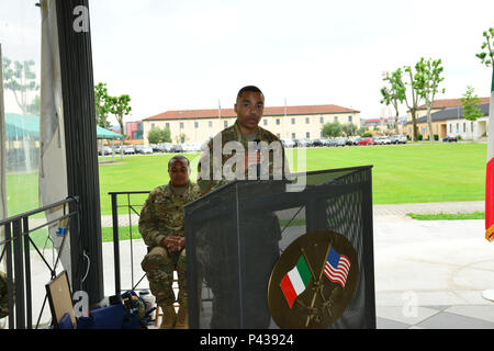 U.S. Army Lt. Col. Brian Cunningham, 2d Military Intelligence Battalion Commander, addresses the audience during Vicenza Military Intelligence Detachment's change of command ceremony at Caserma Ederle, Vicenza, Italy June 9, 2016. Capt. Edward Usilton replaced Capt. Nikesh Kapadia as the commander of Vicenza MI Detachment. (U.S. Army Photo by Visual Information Specialist Davide Dalla Massara/released) - Stock Photo