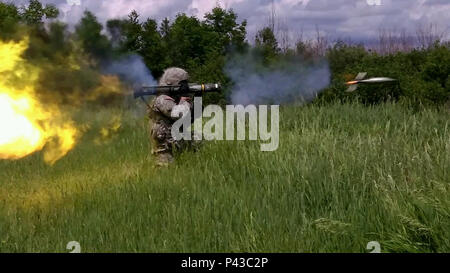 New York Army National Guard Spc. Jarrett Lucas, a member of the 206th MP Company's Detachment 1 located in Utica, N.Y. fires the M136 AT4 Anti-tank weapon at Fort Drum, N.Y. on Tuesday, June 7, 2016 during the company's Annual Training. The company, stationed in both Utica, NY and Latham, NY, focused on individual, crew, and team proficiency, emphasizing basic Soldier skills encompassed in Army Warrior Tasks. ( U.S. Army National Guard photo bySgt. 1st Class Matthew Ball/ Released ) - Stock Photo
