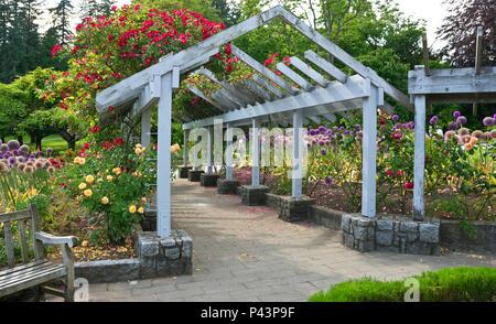 Beautiful flower gardens in Stanley Park, Vancouver, BC, Canada.  June 2018. Vancouver Stanley Park rose and flower garden in June. - Stock Photo