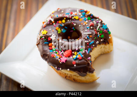 A chocolate donut with sprinkles from Picnic Too, a popular cafe and restaurant in Victoria, British Columbia, Canada. - Stock Photo