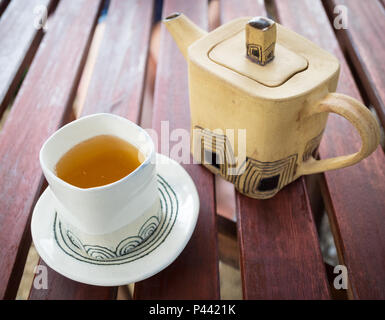 A cup and teapot of green tea from Westholme Tea Farm, near Duncan, British Columbia, Canada. - Stock Photo