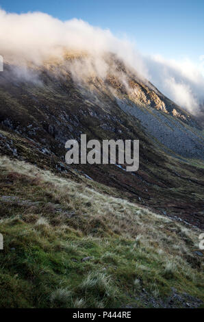 A low lying cloud at Hares Gap on the Mourne Mountains. - Stock Photo
