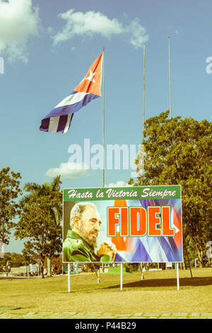 SANTA CLARA, CUBA-JANUARY 6, 2017: Poster with image of Fidel Castro and Cuban flag in the Revolution square in Santa Clara, Cuba. Image with vintage  - Stock Photo