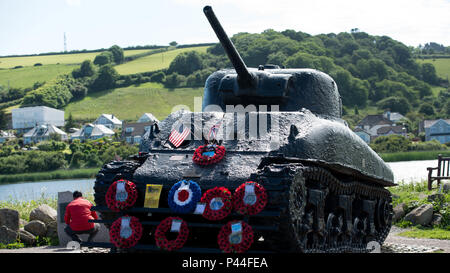TOURBAY, England – The All-Marine running team visits the memorial for Operation Tiger, June 24, 2016. The Sherman Tank was used in the D-Day practice at Slapton Beach. The tank was recovered in 1984 and is now a memorial to the 946 American service members who lost their lives that day. (Official Marine Corps photo by Lance Cpl. Timothy R. Smithers) - Stock Photo