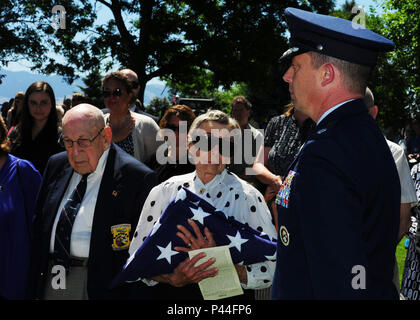 Dawn Thatcher, wife of Staff Sgt. David J. Thatcher, receives the flag during a funeral service June 27 in Missoula, Mont. At 20 years old, Sgt. Thatcher was an engineer gunner in Flight Crew 7 of the Doolittle Tokyo Raids. His crew crash-landed into sea off the coast of China on April 18, 1942. Thatcher saved four members of the crew by pulling them to safety on the surrounding beach and applying life-saving medical treatment, even though he was injured himself. - Stock Photo