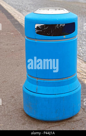 Blue plastic trash can at street - Stock Photo