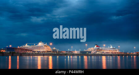 Luxury cruise liners at sea port night view. Two large passengers ships at harbor of Saint Petersburg, Russia - Stock Photo
