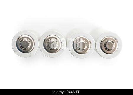 Four white AA batteries top view. Isolated on white - Stock Photo