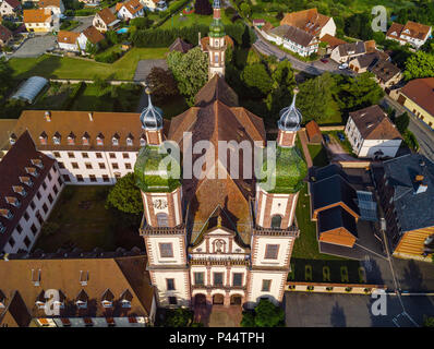 Soaring majestic church Saint Maurice in little french village Ebersmunster. Aerial drone view. Alsace. France. - Stock Photo