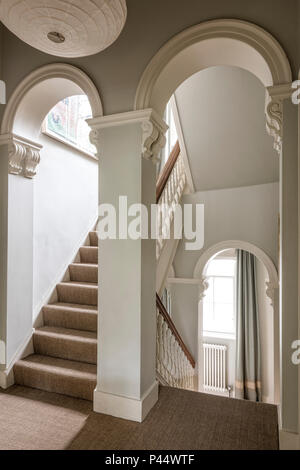 Elegant Victorian arches in stairway - Stock Photo